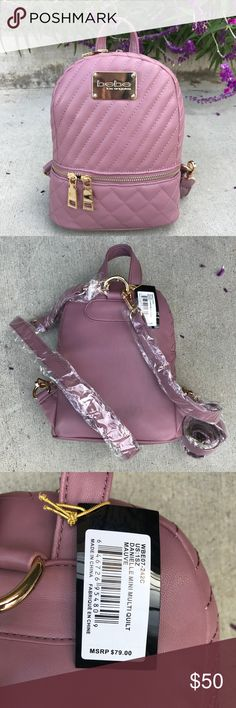"""bebe Danielle Mini Quilt Faux Leather Backpack The color of this bag is even more beautiful in person . This BRAND NEW bebe bag features Quilt stitching along with 1 inner zip pocket and 2 inner pouch pockets. DIMENSIONS: 9"""" x 7"""" x 3"""" bebe Bags Backpacks"""