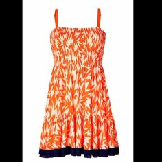 """Juicy Couture Lightning Orange Smocked Dress Juicy Couture Lightning Orange Smocked Dress A vibrant print covers this super sweet summer-ready smocked frock from Juicy Couture. Square smocked bodice, adjustable spaghetti straps, tiered full skirt with contrasting colorblock hem. Style with a denim jacket and wooden wedge sandals. Stretchy. 100% Polyamide Style# JG005867 P194 Size: Small Approximate Measurements-  (Lying Flat, Straight Across) Bust: 13.5"""" Waist: 15"""" Hips: 20"""" Length: 28""""  New…"""
