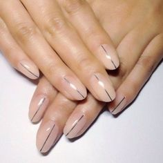 A subtle nude manicure with a single accent line is simple but sharp.