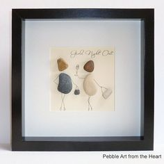 pebble art of two girls with handbags and wine having night out