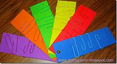 Fine motor skills, paper clips onto card. Can use for colour matching or counting. This would be good in a math center!