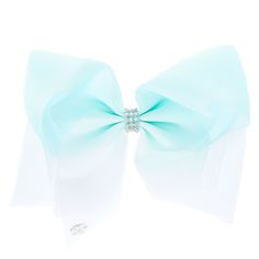 Get the ultimate dancing hair accessory with this super fun largemint & white ombrecoloredsignature hair bow fromJoJo Siwa collection. The bow has been attached to a metal salon clip making it really easy to wear and has been covered in rhinestones so you will sparkle from head to toe.<UL><LI>JoJo Siwa collection</LI><LI>Large white & mint ombre design</LI><LI>Metal salon clip</LI></UL><P>The JoJo Si...