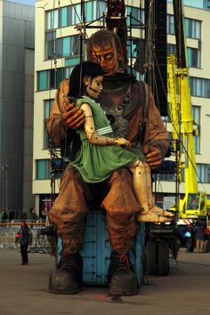 """Little Giant Girl is reunited with her uncle See my other images from """"events in Liverpool"""" by going to https://www.flickr.com/photos/wellsie82/sets/72157637522767906  #giants #liverpool #royaldeluxe #seaodyssey #giantspectacular #streettheatre"""