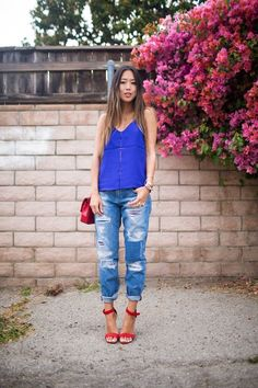 A blue tank and blue ripped boyfriend jeans will convey a carefree, cool-girl vibe. Add red leather heeled sandals to your look for an instant style upgrade.   Shop this look on Lookastic: https://lookastic.com/women/looks/blue-tank-blue-boyfriend-jeans-red-heeled-sandals/17904   — Blue Tank  — Red Leather Crossbody Bag  — Blue Ripped Boyfriend Jeans  — Red Leather Heeled Sandals