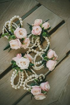 Pink rose and pearl corsages.