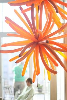 Huge balloon stars made from straight balloons! (would also be really cool in red white and blue to make fireworks balloons for 4th of July!)