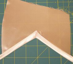 GREAT tutorial for how to sew bias tape on an inverted corner :)