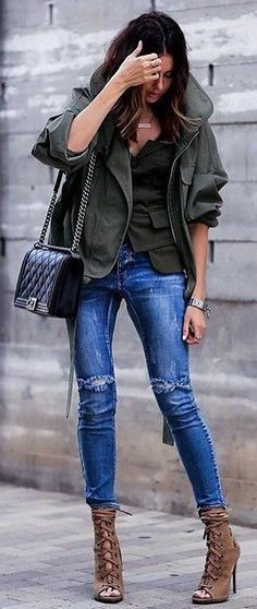 Khaki jacket and top with blue jeans.