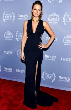 KATE BECKINSALE  in a low-cut, v-neck sleeveless gown with side cut-outs and a thigh-high slit, which she paired with a gold statement necklace and her signature ponytail at the 2016 San Diego International Film Festival in San Diego.  http://people.com/style/last-nights-look-celebrity-red-carpet-photos-092616/kate-beckinsale
