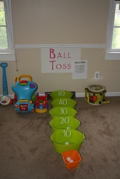 """Ball Toss. Would also make a great """"rainy day"""" activity. You could even find tubs or buckets of varying sizes (like nesting bins) for more of a challenge for the older kids (Think Skee-ball)."""