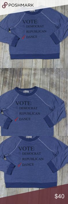 """Wildfox Vote Dance Sweatshirt Pullover Marled Wildfox Women's Vote Dance Pullover Sweatshirt/Top.  Size Medium.  Blue with """"Vote: Democrat, Republican, Dance"""" on it. Marled with a two larger white spots on front and back (intentional, but please review photos!).  75% cotton, 25% polyester.  Machine wash.  In good, preowned condition with no flaws noted.  Measures approximately 24"""" pit to pit, 25"""" shoulder to hem.  No trades, offers welcome. Wildfox Tops Sweatshirts & Hoodies"""