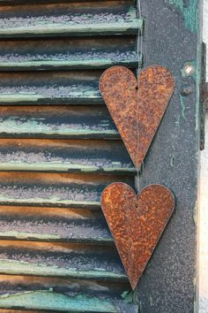 Rusty Hearts...on a green shutter.