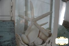 decorating ideas for a beachy summer mantle from aqualanedesign.com  #beachy #coastal #nautical #summer #mantle #starfish #seashells #lantern
