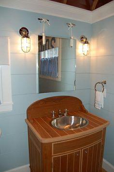 powder room, lights, vanity and sink