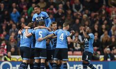 Tottenham routed Stoke City 4-0 with two goals apiece from Harry Kane and Dele Alli to close the gap on Leicester to five points with four games left