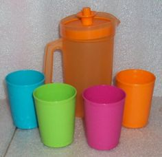 Tupperware Mini Serve It Pitcher and Tumblers Set,Tropical Colors: Plastic and little perfect for our baby proof kitchen!