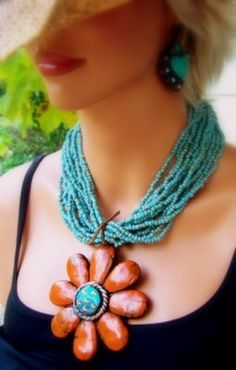 Turquoise and burnt-orange statement necklace. Ok, I'm normally not a fan of bulky jewelry but I'm loving this