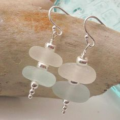 White and aqua sea glass with sterling silver spacers stacked to create beautiful and elegant drop earrings. With sterling silver wire earrings.