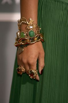 Rihanna's gold link bracelet is worn gathered with several other gold pieces.