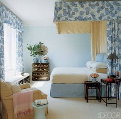 A chrysanthemum-print cotton by Dek Tillett is used for the bed hangings and curtains in a London master bedroom designed by Jeffrey Bilhuber; a 1960s Italian starburst mirror hangs above a 19th-century japanned chest.   - ELLEDecor.com