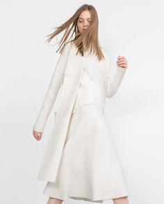 Lange jas met gedrapeerde NECK