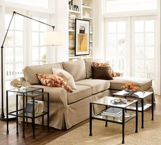 love this look- glass/metal tables and floor lamp with swinging arm