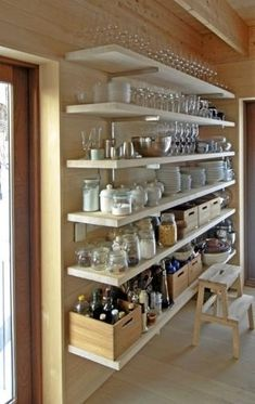 Open shelving may seem like an interesting way of displaying your kitchen items, but they're dust catchers. Do you want to have to dust all this stuff? Enclosed cabinets serve a good purpose.