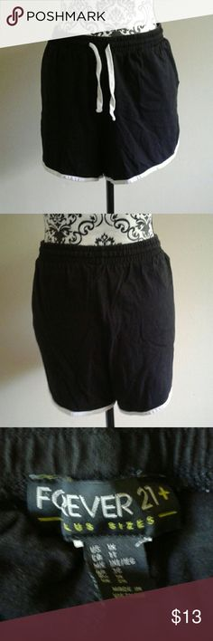 Black and White Athletic shorts Size 1X from Forever 21 Plus black and white athletic shorts. They have an elastic and drawstring waist Forever 21 Shorts