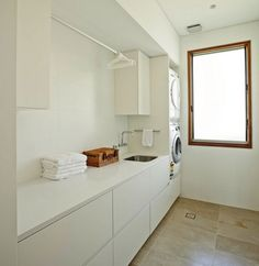 Modern Laundry Room Design Ideas With White Sleek Countertop Cabinets And Built In Wash Machine Also Limestone Flooring: Middle Harbour House in Sydney by Richard Cole Architecture