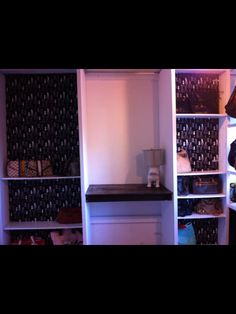 Closet office wall with shelves for purse storage, counter height desk and fabric walls