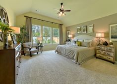 Elegant #master #bedroom with spacious #windows that offer a view of your #garden at Harmony Creek Community.