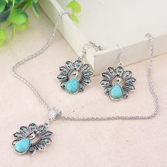 Retro Bohemian Jewelry Set     FREE Shipping Worldwide     http://fashjewels.de/bohemian-retro-national-peacock-turquoise-pendant-necklace-earrings-suit-jewelry-sets-for-women-party-wholesale-drop-shipping/