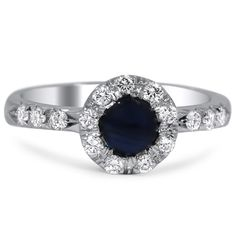"""The Gusty Ring from Brilliant Earth This classically designed Modern estate ring showcases a stunning natural sapphire at the center, surrounded by a glamorous halo of round brilliant diamonds. Diamond accents also decorate the sides of this beautiful piece"" (quote)"