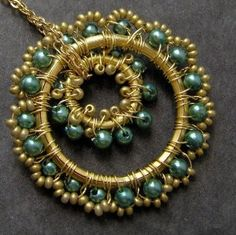 bohemian teal lace pendant>>seems more green here, but lovely either way. I'm SURE my sister can make this for me!