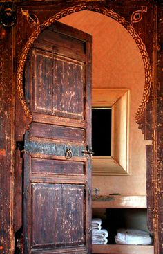 A beautifully hand crafted wooden door could lead to many rooms of mystery - bathroom, bedroom...