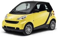 AHHHH!!!! soo cute. SmartCars make my day when i see them driving down the road...even better>>A YELLOW ONE!