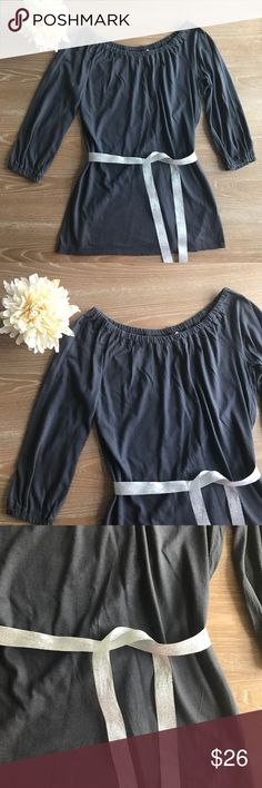 """🚨LAST CHANCE🚨 OFF SHOULDER GRAY TUNIC 💗Condition: EUC, No flaws, no rips, holes or stains. Measurement: armpit to armpit laying flat: 17"""", length: 27"""". Color gray with silver belt. Model wears black 💗Smoke free home/Pet hair free 💗No trades, No returns. No modeling  💗Shipping next day. Beautiful package! 💗I LOVE OFFERS, offer me! 💗ALL ITEMS ARE OWNED BY ME. NOT FROM THRIFT STORES 💗All transactions video recorded to ensure quality.  💗Ask all questions before buying #43 Tops Blouses"""