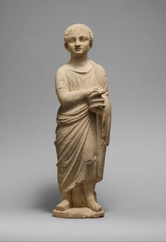 Limestone statue of a youth holding a pyxis  Period:     Late Hellenistic or Republican (?) Date:     3rd–1st century B.C. Culture:     Cypriot