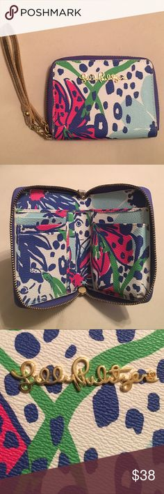 Lilly Pulitzer Charlotte Wristlet Never been carried before. Closure zipper is starting to separate, having fixed and will post more pictures soon. The seam is just pulling apart,  received it as a gift and never used it so I have no explanation as to what caused it. Measures 5' x 4'. Beautiful colors with lovely gold accents!! I'm always open to offers! Lilly Pulitzer Bags Wallets