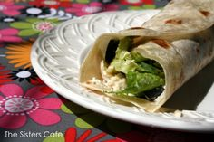 """Chicken Caesar Wraps - The Sisters Cafe(i want to try this except using those greek """"fluffy tortillas"""" (whatever theyre called) and ranch dressing,spinach, and chicken cooked with onion powder:)"""