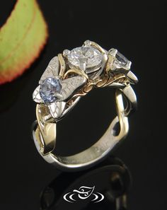 Custom made two toned platinum and 14kt yellow gold twist mounting with platinum butterfly design elements and platinum solid shank at bottom.