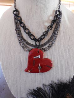 Hey, I found this really awesome Etsy listing at https://www.etsy.com/listing/229805792/tortured-heart-clay-necklace-with-nails