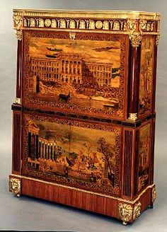 Magnificent secretaire with drop front executed for the court of Spain. Marquetry on all sides with palaces and ruins on the outside and vases and musical instruments on the inside of the piece. The upper part opens to reveal ten drawers and a secret niche