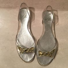 Stuart Wetizmann plastic sandal w rhinestones Stuart Wetizmann slip on clear  plastic sandals with golden rhinestones size 9. Like new. Worn once . Even though they say size 9 and 40 they're definitely not size 40=10. Stuart Weitzman Shoes Sandals