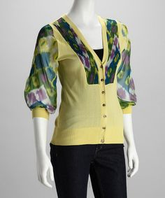 I love this funky little sweater. Add some pop in your wardrobe! Lime and Purple V-Neck Cardigan by Yuka Paris.