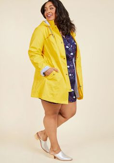 For a rainy morning commute, wet lunchtime stroll, or misty midnight jaunt, this bright yellow raincoat will protect your outfit with style! A marvelous ModCloth exclusive that fastens with snaps, cinches with a drawstring waist, and boasts a hood containing the navy-and-white striped lining found throughout its anorak-like silhouette, this pocketed layer inspires all-weather adventures.