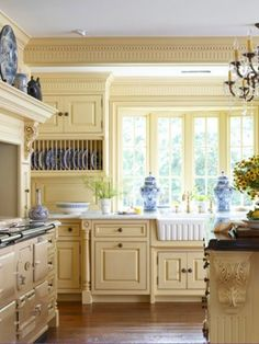Country fresh yellow kitchen with blue accents from the dinnerware and accessories - pretty!