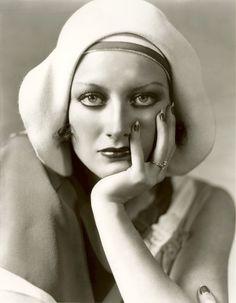 Joan Crawford models a 1920s hat