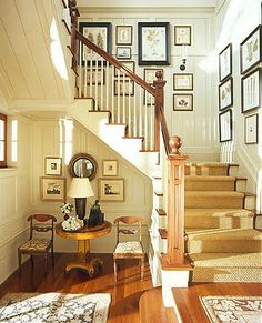 Warm country entry. Love the warm, neutral color scheme with darker wood frames. (And I what about that adorable sitting area?)