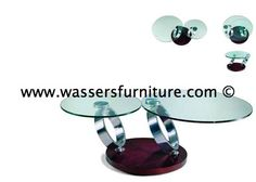Named after the god of the sun, this gorgeous cocktail table definitely lives up to its name.      Apollo features an unmistakable combination of technical engineering and stunning beauty.      Two round glass tops are fused onto steel supports that look as though they defy gravity & open with finger touch effort.    In stock in several options & On display at wasser's Hallandale Beach / Aventura, FL Designer Showroom